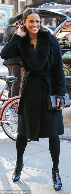 Winter chic: Last Friday, the mother-of-one was seen out in NYC wearing the same style coa...