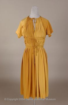 A great two-tone cocktail dress by Claire McCardell, 1949.