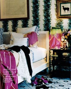 Mathilde Agostinelli's Paris home ~ Madeleine Castaing rug and on fabric covered walls. Jacques Grange.