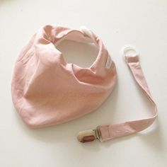 One of our favorites is this beautiful old rose style  Matching bib and pacifier leash.