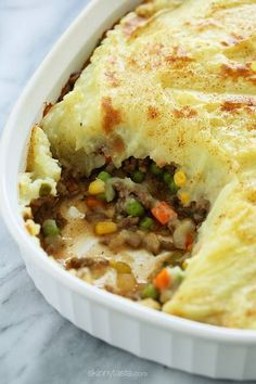 Because St. Patrick's Day is right around the corner, I thought sharing this oldie-but-goodie – my lightened up Shepherd's Pie, filled with lean ground beef, veggies, and topped with my skinny yukon g