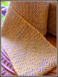 Broken diamond twill leg wraps (wicklebandr, winingas) in blue and yellow wool.