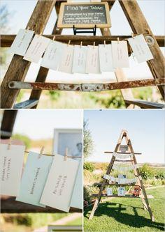 ladder escort card station #diy #escortcards #weddingchicks http://www.weddingchicks.com/2014/02/28/soft-summer-vineyard-wedding/