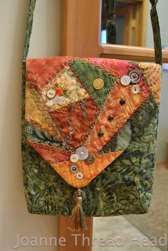 "I ❤ crazy quilting & embroidery . . . Today I made a bag for my new IPad (my birthday present). I have been working on the crazy quilted flap for the past few days. Stitching, buttons, beads, charms, ribbon etc. I started crazy quilting when I was young, and it is still one of my favourites! I recently started using thicker threads (Edmar ""Lola"" is my favourite, but also Kreinik #8 braid & Trebizond silk) & now I think I need to get bigger beads (a trip to the bead store maybe.)"