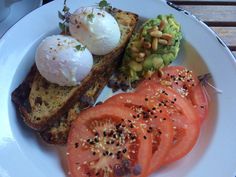 Poached eggs on rye with avo smash