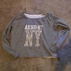 gray areopostale sweatshirt lightly worn small bleach stain on the side at the bottom nothing major Aeropostale Sweaters Cardigans