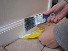 How to Paint ugly 1980s oak baseboards and trim--Hems and Haws: Painting Trim: Slow but worth it