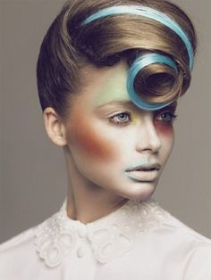 Avant-garde hairstyle with blue highlights and curly fringe