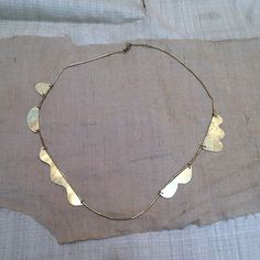 Annie Costello Brown - Hand-cut and hammered brass shapes with tube longEach necklace is unique. Jewelry Art, Jewelry Accessories, Fashion Accessories, Jewelry Necklaces, Jewelry Design, Wabi Sabi, Paper Earrings, Contemporary Jewellery, Bracelets