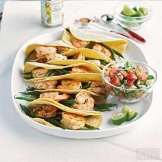 """Just hearing the words """"shrimp tacos"""" is enough to make us hungry. The addition of fresh green beans and homemade tomato salsa makes this recipe utterly irresistible."""