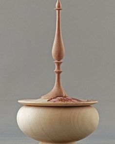 "A ring box by Jay Mapson with a tall finial. The base of the finial is carved to fit around the beautifully pyrographed and colored flowers done by Lin Mapson. The box and lid are maple and the finial is dogwood. 2.5"" X 5"""