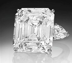 EMERALD CUT CENTER  AND PEAR SIDES  DIAMOND RING