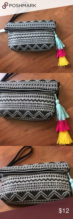 🍩 3/$25 Black and white tribal print wristlet - black and white tribal print - zipper - wristlet strap  My fave part: the colorful tassels! So cute  Note: this is NWT, but when bought it did not include the crossbody straps. It does have the strap for the wristlet Bags Clutches & Wristlets