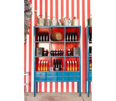 """Swanson Vineyard's Sip Shoppe: The interior smacks of a 1950s soda pop shop, courtesy of candy-red striped walls. This modern day take serves kooky wine and food pairings like the Dizzy Lizzy sno-ball and a caviar-capped potato chip served with Pinot Grigio. Wine sips savored from mini Riedel """"O"""" glasses, glass Dixie cups and pint-sized crystal cordials cement the playful scene. Try New Orleans Iced Coffee Roadie, Clark's Bark (salted toffee enrobed in chocolate) and Alexis Bonbons."""