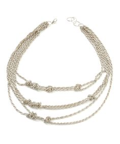 Take a look at this Silver & Gold Aztec Knot Necklace on zulily today!