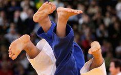 Japan's Masashi Ebinuma and Kazakhstan's Sergey Lim  //   men's  judo match at the London 2012 Olympic Games