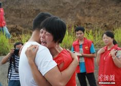 A brother and sister are overcome with emotion upon being reunited after more than 34 years apart in Santai county, Sichuan Province.