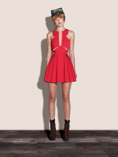 Three Floor Fashion's Look See dress. A beautiful poppy red-hued dress in a fit and flare skater design. Features include: mesh inserts, side cut outs, interest neckline and pleated skirt. Impact guaranteed.