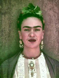 Frida with beautiful broach, earnings, eyebrows, and moustache.
