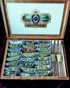 Wicca Herb Kit, Witchcraft Herb Kit, Starter Herb Kit. 26 Herbs + 3 salts and Brimstone with 5 glass bottles, a muslin bag all in an old cigar box. Perfect for the Beginner Witch or a seasoned one that wants a handy kit for spells. #themagickcabinet #herbsforwitches #beginnerwitch