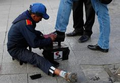 In this July 7, 2014, photo, Lucas, 13, polishes shoes on a street in La Paz, Bolivia. While most of the rest of the world is trying to diminish child labor, Bolivia is on the verge of becoming the first nation legalize it from age 10. Congress has approved the proposal and all that's now required is President Evo Morales' signature. (AP Photo/Juan Karita)