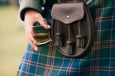 man in a kilt holds a glass of whisky. In Scotland will hold a . Irish Gaelic Names, Drinking Toasts, Le Kilt, Speyside Whisky, Tweed, Scotland History, Whisky Tasting, Scottish Clans, Water Life
