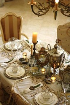 Stunning, great steam punk wedding tables cape. Love the old lace and silver serving pieces used as a centerpiece.
