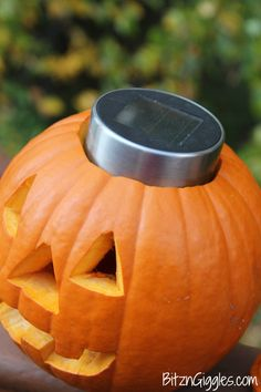 Solar Light Pumpkin...but alter this to cut open plastic pumpkins. Reuse every year!