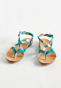 Even your mellow attitude can't hold back your glee over these colorful sandals by Blowfish! Combining teal, orange, ivory, cerulean, and plum hues with a minimalist platform sole, these strappy, faux-leather flats crisscross around your feet with straightforward ease.