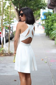 Krystal Bick of This Time Tomorrow in our  Raffia Racer Back Flare Dress. Gorgeous.