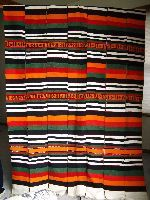 HausA cloth, Niger..made from four to eight inch wide strips.  similart to Kente but woven on a wider loom and not on silk or rayon