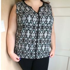 Diamond print tank So cute! It's a black and off white colored tank with hints of green. V neckline. It has a diamond printed pattern on it. 100% polyester. Fits more like 2x. I'm modeling as 18/20, 40 f/g, 5'7. Pure Energy Tops Tank Tops