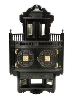 Anglo-Japanese style ebonised hanging corner cupboard c1875, in manner of Christopher Dresser by Hummerson Bros Leeds.