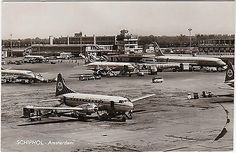 K.L.M Royal Dutch Airlines at Schiphol Airport in Amsterdam. Showing Douglas dc-7 & 8. The card was postally used in 1963.
