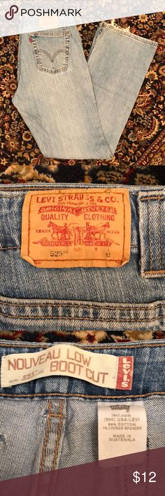 Levi Jeans Levi Strauss & Co. 525 boot cut, size 12. Does have a hole on back left pocket as shown in picture and some fraying in the cuffs. Levi's Jeans Boot Cut