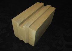 Titan Brick is made of 90% dirt waterproofed with non-toxic chemicals. It features R-20 insulating power plus superior strength compared to concrete blocks.