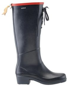 AIGLE: rain boots or some petroleum molded into boots are my personal favorite.