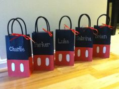 "Custom Birthday goody bags for a Mickey mouse birthday party! Simple black lunch sized bags and red ones, cut the red bags to desired height and glue to black bag. Glue white ""buttons"" on front. Black pipe cleaners for bag handles and a silver sharpie to write the kids names! These were a hit!! All supplies from A.C. Moore"