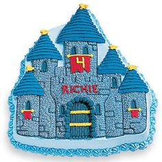 Prepare for Knighthood Castle Cake - Dub him Sir Richie on his 4th birthday! Create a blue-on-blue Enchanted Castle Pan cake brightened with red and yellow piped-icing elements.