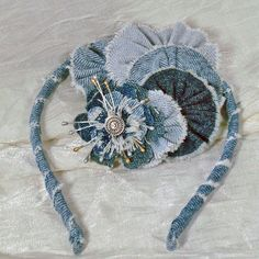 This versatile denim flower is a hairclip, a brooch, and/or a headband. Maybe you want to put it on a hat or purse. Only you know. And you know