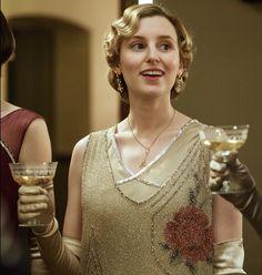 Lady Edith drinks a toast. Downton Abbey