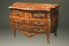 Circa 1890, this French Louis XV Style commode is made with a mixture of exotic woods—rosewood, mahogany, satinwood, and tulipwood. Read more about this piece on our blog: http://www.beauchampantiques.com/?p=110380