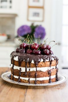 Black Forest Gateau with Cherries is a chocolate cake brushed w/Kirsch, cherry jam & cream Chantilly, covered in chocolate ganache.