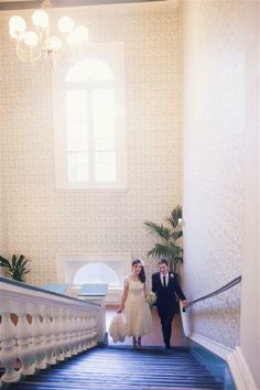 Steve & Ellie on the Grand Staircase http://whimsicalwonderlandweddings.com/2012/04/victoria-hall-saltaire-wedding.html