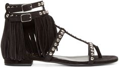 Flat suede sandals in black. Round silver-tone studs at fringed t-strap. Double ankle straps with pin-buckle adjustable closures. Buffed leather sole. Tonal stitching.