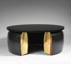 BRACELET COFFEE TABLE BY ERIC SCHMITT | A limited edition coffee table made from patinated and polished bronze. | http://bocadolobo.com/blog/ #limitededition