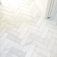 satin white bathroom floor tile in a herringbone design royal satin white marble subway tile