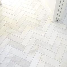Satin white bathroom floor tile in a herringbone design - Royal Satin White Marble Subway Tile - 4 x 12 in.