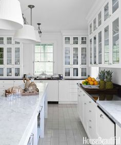 Bright and white kitchen in a home in the Bahamas (via House Beautiful).