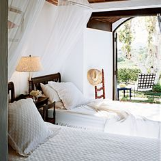 Light and Breezy - Coastal Living Mosquito netting is essential to open-air island bedrooms, but the flowy material has exotic appeal everywhere. Hang netting from a canopy bed frame like curtains or suspend it, hoop-style, from the ceiling.  Idea Spotlight Find a fresh way to use pattern other than on the bedding. Try it on lamp shades, or frame poster-size pieces of botanical wallpaper.